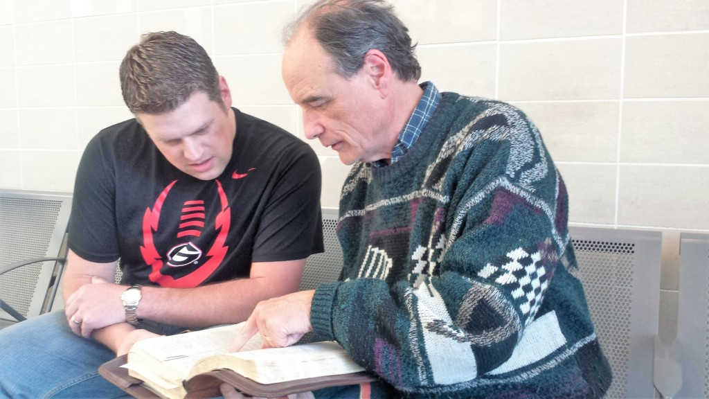 David, searching the Scriptures together with a volunteer.